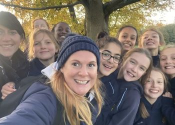 The U12 team display their strength in GDST Netball Tournament