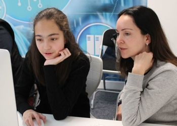 Girls teach their parents how to code in 'Hour of Code'