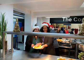 Our Senior Leadership Team in festive spirit serving Christmas lunch to students and staff