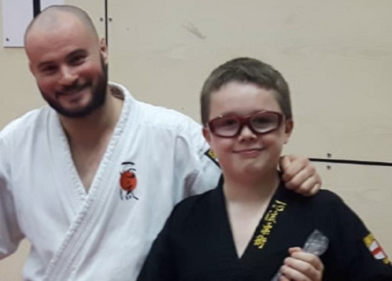 Thomas Receives Brown / Black Belt
