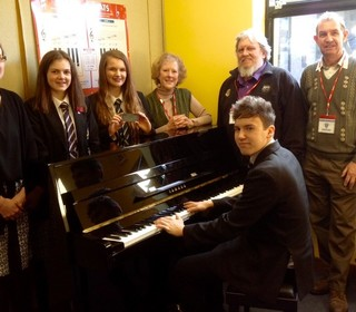 United charities piano donation