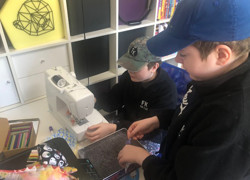 Boys develop sewing to help those in need