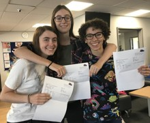 Twins Laura and Helen Harmer celebrate their results with fellow Hinchley Wood student Helen Youssef (right)