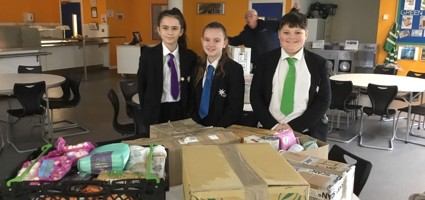 Students delivering their donation to Canterbury Food Bank