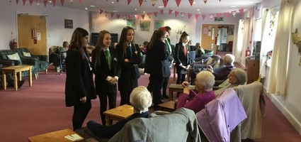 Carol singing with Age UK