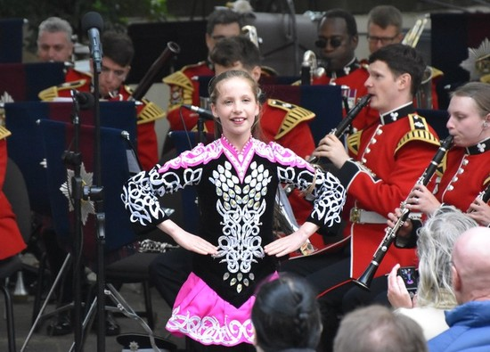 Dance champion performs with the Band of the Irish Guards in London